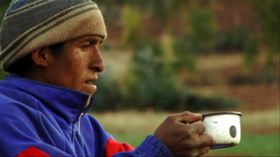 Peruvian man drinking from mug