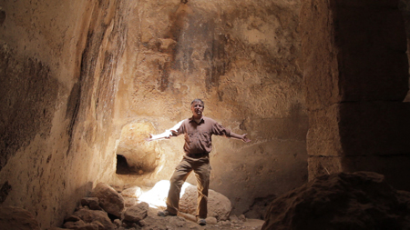 Archaeologist in Tal Hisban cave