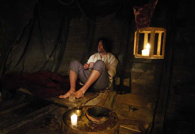 Man sitting in ship's hold (re-enactment)