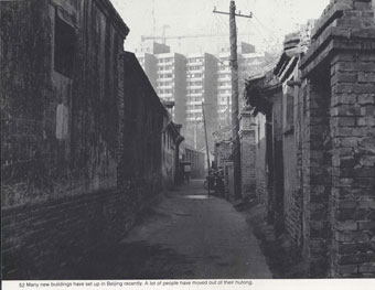 Hutong Neighborhood with Modern Apartment Buildings in Background