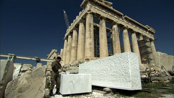 Man Working on Stones in Front of Parthenon